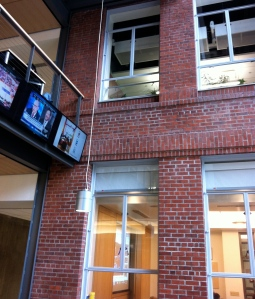 TV monitors show news around the world in the Allen Atrium.