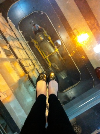 Standing on fiberglass looking down into a storage area of the carrier. Eeek! Looooong way down.